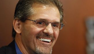 FILE - In this May 7, 2014, file photo, Philadelphia Flyers general manager Ron Hextall laughs during an NHL hockey news conference in Philadelphia. Mario Lemieux and the Pittsburgh Penguins are turning to a former rival to help them keep the Stanley Cup window open for Sidney Crosby and company. The team hired former Philadelphia Flyer goaltender and general manager Ron Hextall as the team's general manager on Tuesday, Feb. 9, 2021. (AP Photo/Matt Slocum, File)
