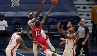 New Orleans Pelicans forward Brandon Ingram (14) goes to the basket against Houston Rockets forward Danuel House Jr. in the first half of an NBA basketball game in New Orleans, Tuesday, Feb. 9, 2021. (AP Photo/Gerald Herbert)