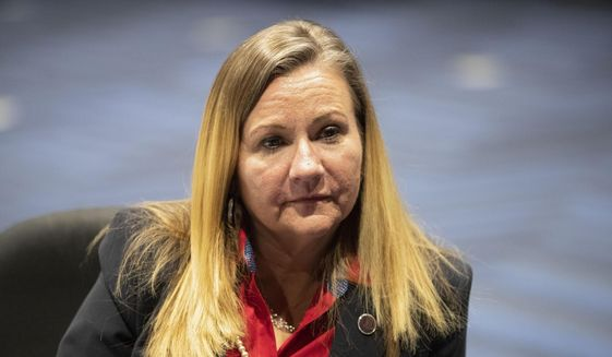 In this Feb. 2, 2021, photo, Virginia Sen. Amanda Chase and Republican gubernatorial candidate, speaks from her desk at the Science Museum of Virginia in Richmond, Va. (AP Photo/Ryan M. Kelly) **FILE**