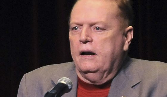 """Larry Flynt speaks in Los Angeles, Calif. Flynt is offering """"up to $10 million"""" to anyone who produces information that leads to President Donald Trump's impeachment and removal from office. He lays out the offer in a full-page ad in the Sunday edition of The Washington Post. (AP Photo/Katy Winn, file)"""
