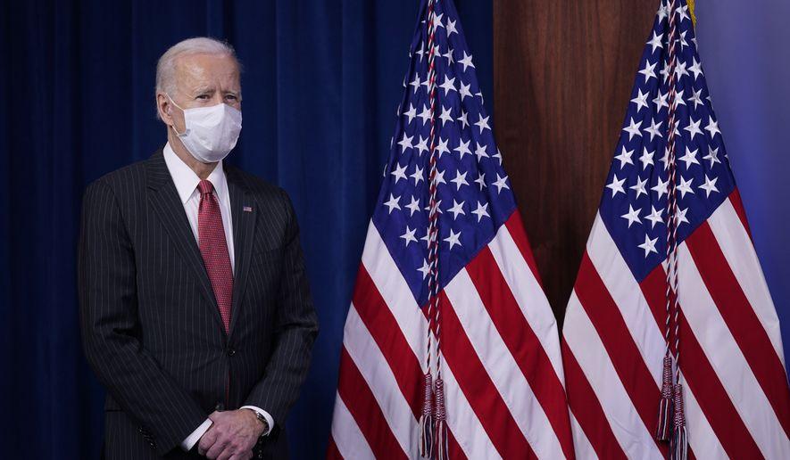 President Joe Biden waits to speak to Department of Defense personnel alongside Vice President Kamala Harris and Defense Secretary Lloyd Austin at the Pentagon, Wednesday, Feb. 10, 2021, in Washington. (AP Photo/Patrick Semansky)