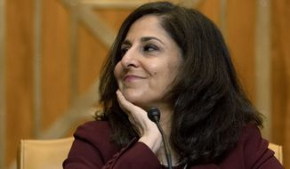 Neera Tanden, President Joe Biden's nominee for Director of the Office of Management and Budget (OMB), appears beofre a Senate Committee on the Budget hearing on Capitol Hill in Washington, Wednesday, Feb. 10, 2021.(AP Photo/Andrew Harnik, Pool)