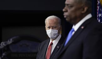 President Joe Biden listens as Secretary of Defense Lloyd Austin speaks at the Pentagon, Wednesday, Feb. 10, 2021, in Washington. (AP Photo/Alex Brandon, Pool)