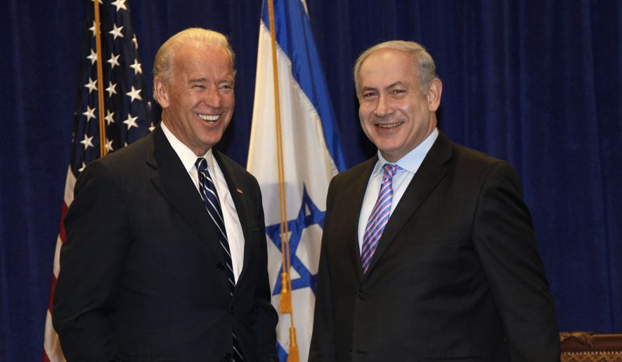 FILE - In this Nov. 7, 2010 file photo, Vice President Joe Biden meets with Israeli Prime Minister Benjamin Netanyahu at the annual General Assembly of the Jewish Federations of North America in New Orleans.   Israelis are expressing growing concern that President Joe Biden has yet to call Netanyahu in the three weeks since his inauguration in Jan. 2021. Some fear that it could forecast a chillier relationship after President Donald Trumps warm embrace. (AP Photo/Gerald Herbert, File)