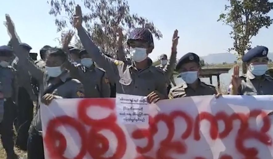 In this image made from video, dozens of police show their support for pro-democracy supporters denouncing last week's government coup Wednesday, Feb. 10, 2021, in Bardo village, Kayah State, Myanmar. (Khunbwe Mue via AP)