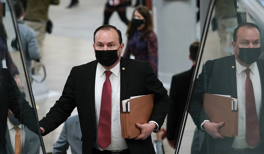 Sen. Mike Lee, R-Utah, walks on Capitol Hill in Washington, Wednesday, Feb. 10, 2021, as he heads to the second day of the second impeachment trial of former President Donald Trump. (AP Photo/Susan Walsh)