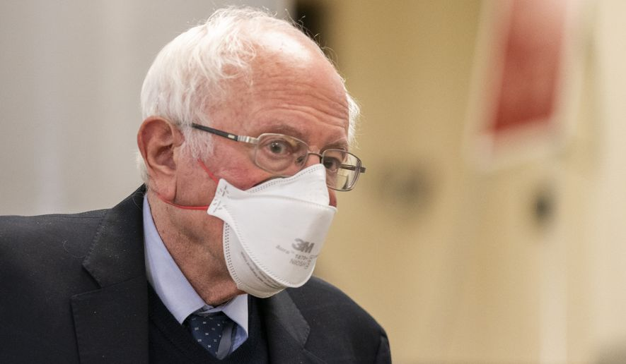 Sen. Bernie Sanders, I-Vt., leaves the Capitol at the conclusion of the second day of the second impeachment trial of former President Donald Trump, on Capitol Hill in Washington, Wednesday, Feb. 10, 2021. (AP Photo/Manuel Balce Ceneta)