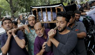 FILE- In this Nov. 1, 2015 file photo, Bangladeshi people carry the body of Faisal Arefin Deepan, a publisher of secular books, during his funeral in Dhaka, Bangladesh, . A special tribunal in Bangladesh's capital on Wednesday sentenced to death eight Islamic militants tied to a banned group for the 2015 killing of the publisher of books on secularism and atheism. (AP Photo/ A.M. Ahad, File)