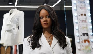 FILE - Rihanna poses as she unveils her first fashion designs for Fenty at a pop-up store in Paris, France, on May 22, 2019. LVMH Moët Hennessy Louis Vuitton, the world's largest luxury group, has put Rihanna's Fenty fashion collection on hold. The move, confirmed by LVMH Wednesday, comes nearly two years after the fashion conglomerate announced the collaboration with the pop artist and business mogul.  (AP Photo/Francois Mori, File)