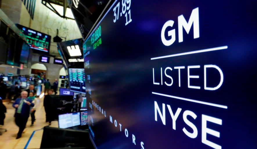 In this April 23, 2018, file photo, the logo for General Motors appears above a trading post on the floor of the New York Stock Exchange. (AP Photo/Richard Drew, File)