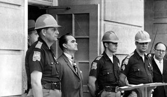 In this June 11, 1963, file photo, Gov. George Wallace blocks the entrance to the University of Alabama as he turned back a federal officer attempting to enroll two black students at the university campus in Tuscaloosa, Ala.  (AP Photo/File)  ** FILE **