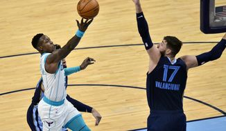 Charlotte Hornets guard Terry Rozier shoots against Memphis Grizzlies center Jonas Valanciunas (17) in the second half of an NBA basketball game Wednesday, Feb. 10, 2021, in Memphis, Tenn. (AP Photo/Brandon Dill)