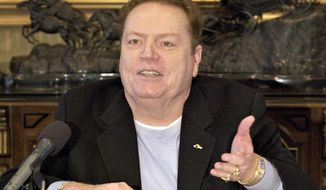 "FILE - Larry Flynt Publications Inc. (LFP) Publisher Larry Flynt comments on the resignation of former New York Governor Eliot Spitzer, during an interview with The Associated Press in his office in Beverly Hills, Calif. on March 14, 2008. Flynt, who turned ""Hustler"" magazine into an adult entertainment empire while championing First Amendment rights, has died at age 78. His nephew, Jimmy Flynt Jr., told The Associated Press that Flynt died Wednesday, Feb. 10, 2021, of heart failure at his Hollywood Hills home in Los Angeles. (AP Photo/Damian Dovarganes, File)"