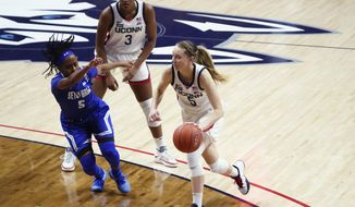 Connecticut guard Paige Bueckers, right, drives the ball against Seton Hall guard Mya Jackson during the first half of an NCAA college basketball game Wednesday, Feb. 10, 2021, in Storrs, Conn. (David Butler II/Pool Photo via AP)