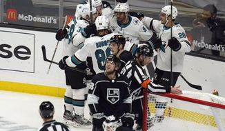 The San Jose Sharks celebrate after a goal scored by San Jose Sharks left wing Evander Kane (9) during the third period of an NHL hockey game Wednesday, Feb. 10, 2021, in Los Angeles. (AP Photo/Ashley Landis)