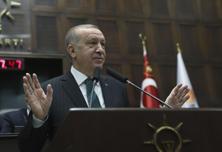 Turkish President Recep Tayyip Erdogan addresses his ruling party legislators, in Ankara, Turkey, Wednesday, Feb. 10.2021.  Erdogan on Wednesday ruled out discussing a federal system to reunify Cyprus, insisting that a two-state accord is the only solution for the ethnically-split island. (Turkish Presidency via AP, Pool)