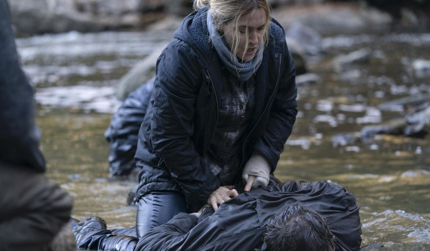 """This image released by HBO shows Kate Winslet in a scene from """"Mare of Easttown,"""" debuting on April 18. (HBO via AP)"""