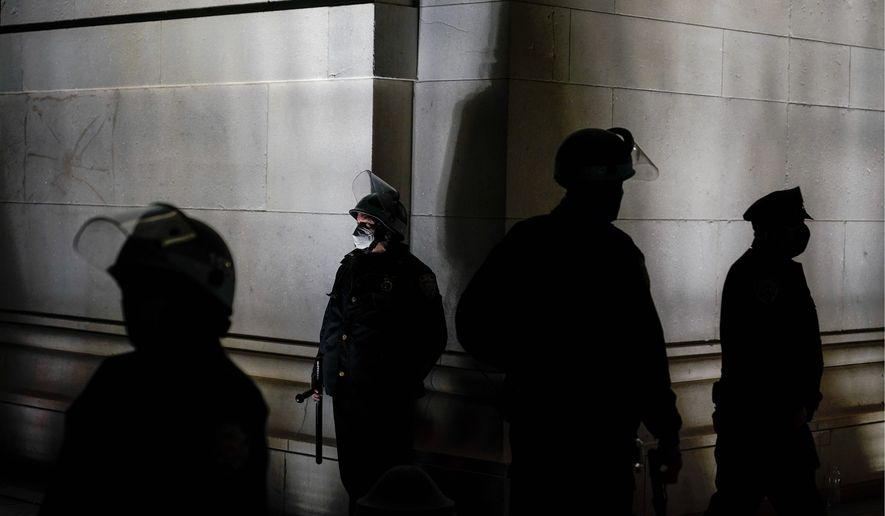 Law enforcement agencies lack a strategy to identify White supremacists lurking in the shadows. Since last summer's racial justice protests, some police departments have adopted programs to address implicit bias but not to root out explicit racism. (Associated Press)