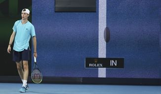 France's Ugo Humbert waits as a video replay is shown behind him during his second round match against Australia's Nick Kyrgios at the Australian Open tennis championship in Melbourne, Australia, Wednesday, Feb. 10, 2021. (AP Photo/Hamish Blair)  **FILE**