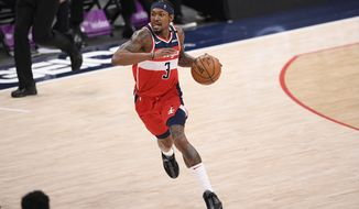 Washington Wizards guard Bradley Beal (3) dribbles the ball during the first half of an NBA basketball game against the Toronto Raptors, Wednesday, Feb. 10, 2021, in Washington. (AP Photo/Nick Wass)