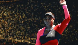 United States' Serena Williams waves after defeating Serbia's Nina Stojanovic in their second round match at the Australian Open tennis championship in Melbourne, Australia, Wednesday, Feb. 10, 2021.(AP Photo/Rick Rycroft)