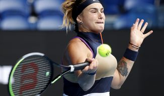 Aryna Sabalenka of Belarus makes a forehand return to United States' Ann Li during their third round match at the Australian Open tennis championship in Melbourne, Australia, Friday, Feb. 12, 2021.(AP Photo/Rick Rycroft)