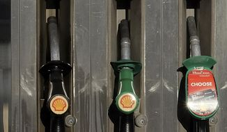 In this Wednesday, Jan. 20, 2016 file photo, the Shell logo on pumps at a petrol station in London. Global energy company Shell said it plans to eliminate seven refineries and reduce production of gasoline and diesel fuel by 55% over the next decade as it unveiled new plans for reaching its goal of being carbon neutral by 2050. (AP Photo/Kirsty Wigglesworth, File)  **FILE**