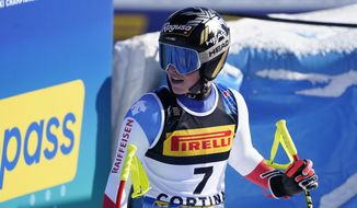 Switzerland's Lara Gut-Behrami reactss as she arrives at the finish area during the women's super-G, at the alpine ski World Championships in Cortina d'Ampezzo, Italy, Thursday, Feb. 11, 2021. (AP Photo/Giovanni Auletta)