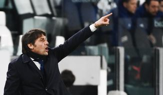 Inter coach Antonio Conte directs his team during the Italian Cup, return-leg, semifinal soccer match between Juventus and Inter Milan, at the Turin Allianz Stadium, Italy, Tuesday, Feb. 9, 2021. (Marco Alpozzi/LaPresse via AP)