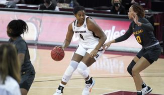 South Carolina forward Aliyah Boston (4) works against Missouri forward LaDazhia Williams (0) during the first half of an NCAA college basketball game Thursday, Feb. 11, 2021, in Columbia, S.C. (AP Photo/Sean Rayford)