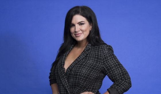 """FILE - This Oct. 19, 2019, file photo shows Gina Carano at the Disney Plus launch event promoting """"The Mandalorian"""" at the London West Hollywood hotel in West Hollywood, Calif. In a statement Wednesday, Feb. 10, 2021, Lucasfilm said Carano is no longer a part of """"The Mandalorian"""" cast after many online called for her firing over a social media post that likened the experience of Jews during the Holocaust to the U.S. political climate. (Photo by Mark Von Holden/Invision/AP, File)"""
