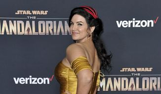 """Gina Carano attends the LA premiere of """"The Mandalorian"""" at the El Capitan Theatre in Los Angeles, Nov. 13, 2019. In a statement Wednesday, Feb. 10, 2021, Lucasfilm said Carano is no longer a part of """"The Mandalorian"""" cast after many online called for her firing over a social media post that likened the experience of Jews during the Holocaust to the U.S. political climate. (Photo by Richard Shotwell/Invision/AP) ** FILE **"""