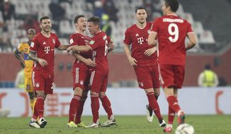Bayern's Benjamin Pavard, second left, celebrates after scoring his side's opening goal during the Club World Cup final soccer match between FC Bayern Munich and Tigres at the Education City stadium in Al Rayyan, Qatar, Thursday, Feb. 11, 2021. (AP Photo)