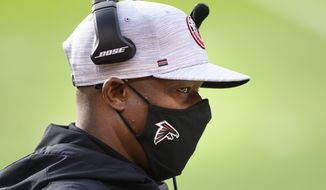 FILE - In this Dec. 27, 2020, file photo, Atlanta Falcons coach Raheem Morris watches during the first half of the team's NFL football game against the Kansas City Chiefs in Kansas City, Mo. Morris has begun work as the Los Angeles Rams' new defensive coordinator with a plan to continue last season's success with several new wrinkles. Morris plans to continue running a 3-4 defense with the players who finished No. 1 in the NFL in several defensive categories last season. (AP Photo/Reed Hoffmann, File)
