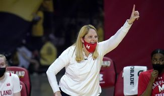 Maryland head coach Brenda Frese reacts during the second half of an NCAA college basketball game against Wisconsin, Thursday, Feb. 4, 2021, in College Park, Md. Frese tied a school record with her 499th win, reaching the milestone by guiding the 10th-ranked Terrapins past Wisconsin 84-48. Frese matched the mark set by Hall of Fame coach Chris Weller, who was at Maryland from 1975-2002. Weller was replaced by Frese, who's 499-130 over 19 seasons. (AP Photo/Julio Cortez) **FILE**