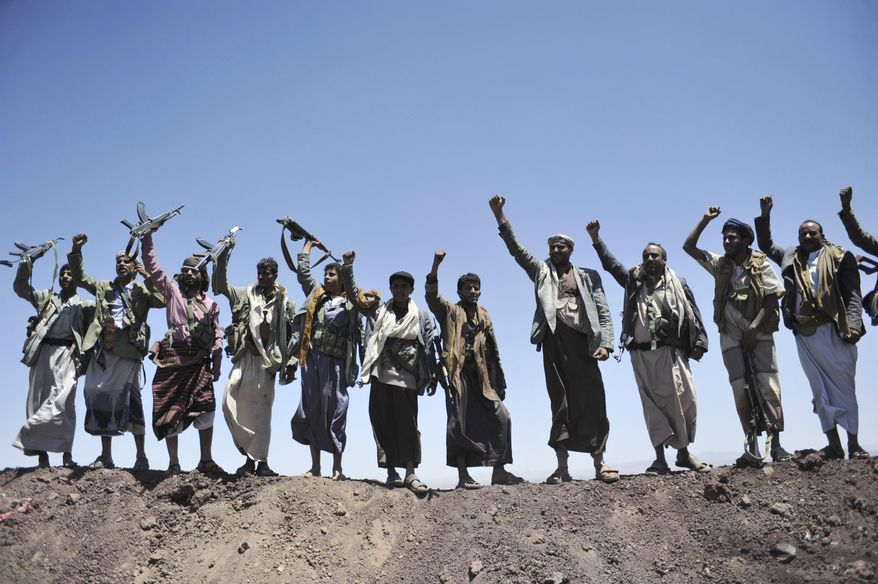 In this Sept. 22, 2014 file photo, Hawthi Shiite rebels chant slogans at the compound of the army's First Armored Division, after they took it over, in Sanaa, Yemen.  Yemen's war began in September 2014, when the Houthis seized the capital Sanaa. Saudi Arabia, along with the United Arab Emirates and other countries, entered the war alongside Yemen's internationally recognized government in March 2015. The war has killed some 130,000 people and driven the Arab world's poorest country to the brink of famine.   (AP Photo/Hani Mohammed, File)  **FILE**