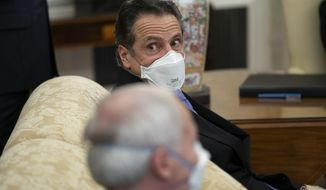 Gov. Andrew Cuomo, D-N.Y., listens to a question during a meeting between President Joe Biden and a bipartisan group of mayors and governors to discuss a coronavirus relief package, in the Oval Office of the White House, Friday, Feb. 12, 2021, in Washington. (AP Photo/Evan Vucci)