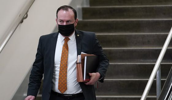 Sen. Mike Lee, R-Utah, walks down the stairs on Capitol Hill in Washington, Friday, Feb. 12, 2021, after the fourth day of the second impeachment trial of former President Donald Trump. (AP Photo/Susan Walsh)