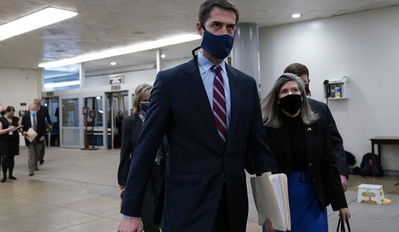 Sen. Tom Cotton, R-Ark., and Sen. Joni Ernst, R-Iowa, walk on Capitol Hill in Washington, Friday, Feb. 12, 2021, on the fourth day of the second impeachment trial of former President Donald Trump. (AP Photo/Susan Walsh)