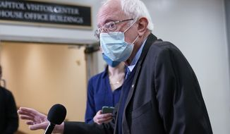 Sen. Bernie Sanders, I-Vt., talks with reporters on Capitol Hill in Washington, Friday, Feb. 12, 2021, on the fourth day of the second impeachment trial of former President Donald Trump. (AP Photo/Susan Walsh)