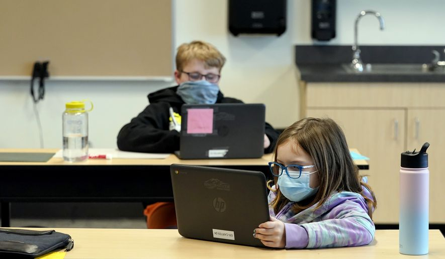 In this Feb. 2, 2021, file photo, students wear masks as they work in a fourth-grade classroom, at Elk Ridge Elementary School in Buckley, Wash. (AP Photo/Ted S. Warren, File)  **FILE**