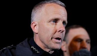 FILE - In this March 21, 2018 file photo, Austin Police Chief Brian Manley briefs the media in the Austin suburb of Round Rock, Texas.  Austin officials said Friday, Feb. 12, 2021, that Manley is stepping down after leading the police force since May of 2018. (AP Photo/Eric Gay, File)