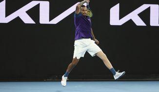 Australia's Nick Kyrgios plays a shot during his third round match against Austria's Dominic Thiem at the Australian Open tennis championship in Melbourne, Australia, Friday, Feb. 12, 2021.(AP Photo/Hamish Blair)
