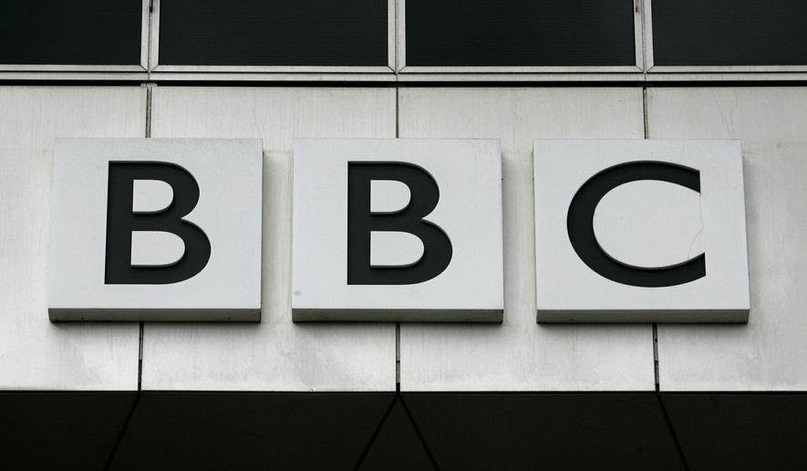 FILE - This Oct. 17, 2007, file photo, shows the BBC, British Broadcasting Corporation sign on their offices at White City in London. China has banned the BBC World News television channel from the few outlets where it could be seen in the country in possible retaliation after British regulators revoked the license of state-owned Chinese broadcaster CGTN. (AP Photo/Kirsty Wigglesworth, File)