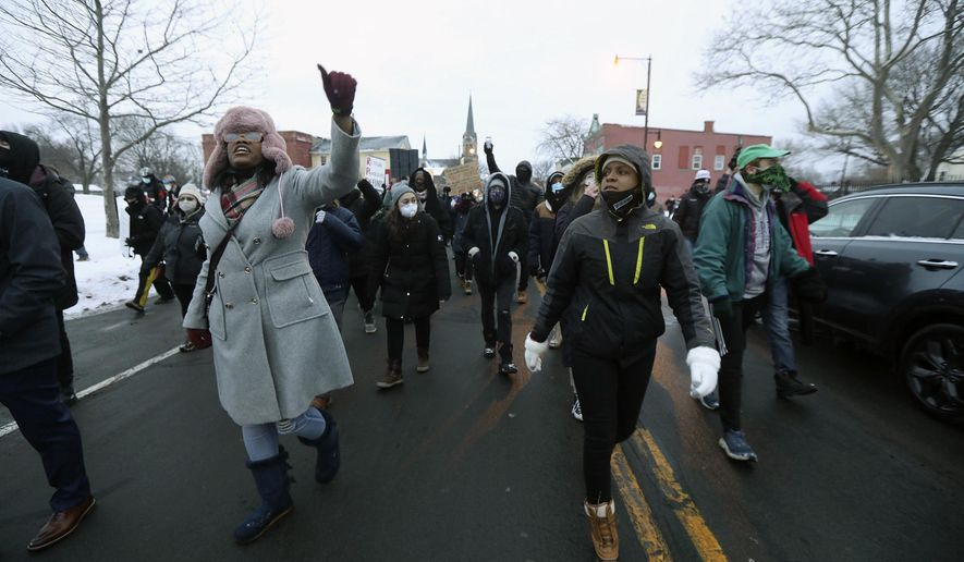 In this Feb. 1, 2021, file photo, Toni Winter, left, chants as she marches with members of Community Justice Initiative and supporters to the Rochester Police Department's Clinton Section, protesting the police handcuffing and pepper spray of a 9-year-old Black girl in Rochester, N.Y. A police officer using pepper spray against the girl has spurred outrage as the latest example of law enforcement mistreatment of Black people, and one that shows even Black children are not exempt. (Tina MacIntyre-Yee/Democrat & Chronicle via AP, File)