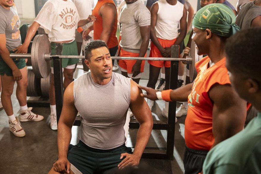 """This image released by NBC shows Uli Latukefu as Dwayne Johnson in a scene from """"Young Rock,"""" debuting on Feb. 16.  (Mark Taylor/NBC via AP)"""