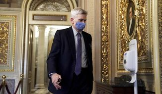 Sen. Bill Cassidy, R-La., walks on Capitol Hill after the Senate acquitted former President Donald Trump in his second impeachment trial in the Senate at the U.S. Capitol in Washington, Saturday, Feb. 13, 2021. Trump was accused of inciting the Jan. 6 attack on the U.S. Capitol, and the acquittal gives him a historic second victory in the court of impeachment. (Greg Nash/Pool via AP)