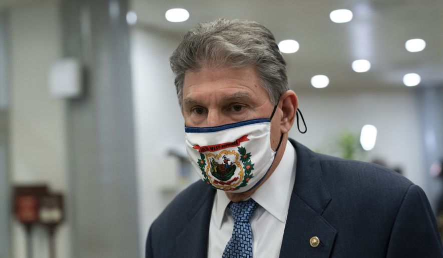 Sen. Joe Manchin, D-W.Va., departs on Capitol Hill in Washington, Saturday, Feb. 13, 2021, after the Senate acquitted former President Donald Trump in his second impeachment trial in the Senate. Trump was accused of inciting the Jan. 6 attack on the U.S. Capitol, and the acquittal gives him a historic second victory in the court of impeachment. (AP Photo/Alex Brandon)