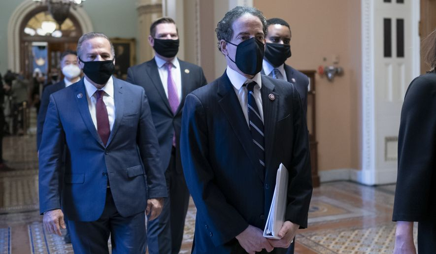 Democratic House impeachment managers, from left, Rep. David Cicilline, D-R.I., Rep. Eric Swalwell, D-Calif., Rep. Jamie Raskin, D-Md., and Rep. Joe Neguse, D-Colo., depart the Senate chamber after the impeachment trial of former President Donald Trump ended, at the Capitol in Washington, Saturday, Feb. 13, 2021. Trump was found not guilty of the charge of inciting the January 6 attack on the Congress by a mob of his supporters. (AP Photo/J. Scott Applewhite)