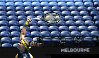Karolina Muchova of the Czech Republic serves to compatriot Karolina Pliskova during their third round match at the Australian Open tennis championship in Melbourne, Australia, Saturday, Feb. 13, 2021.(AP Photo/Andy Brownbill)